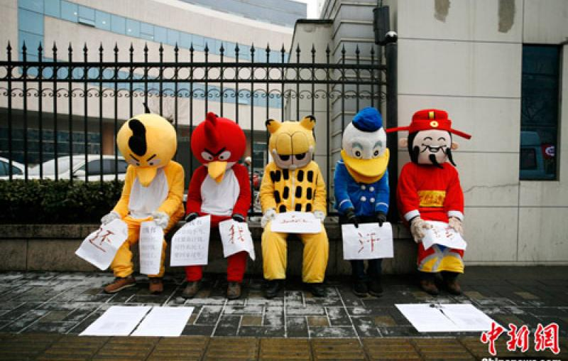 Migrant workers in Beijing dressed in cartoon costumes to protest unpaid wages