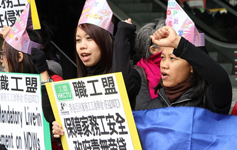 Foreign domestic workers in Hong Kong hold a rally on Sunday, March 3, calling for abolishment of the rule requiring them to live with their employers.