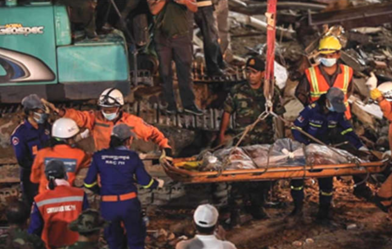 Rescue teams pull out victims from the rubble.