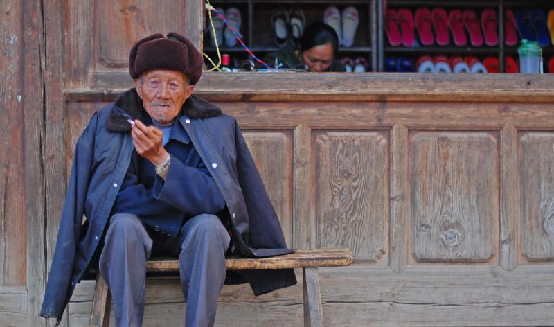 An old man sitting on the bench. Image Credit: Flickr / timquijano